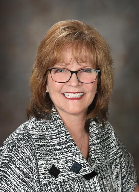 Kelly  A. Corbett